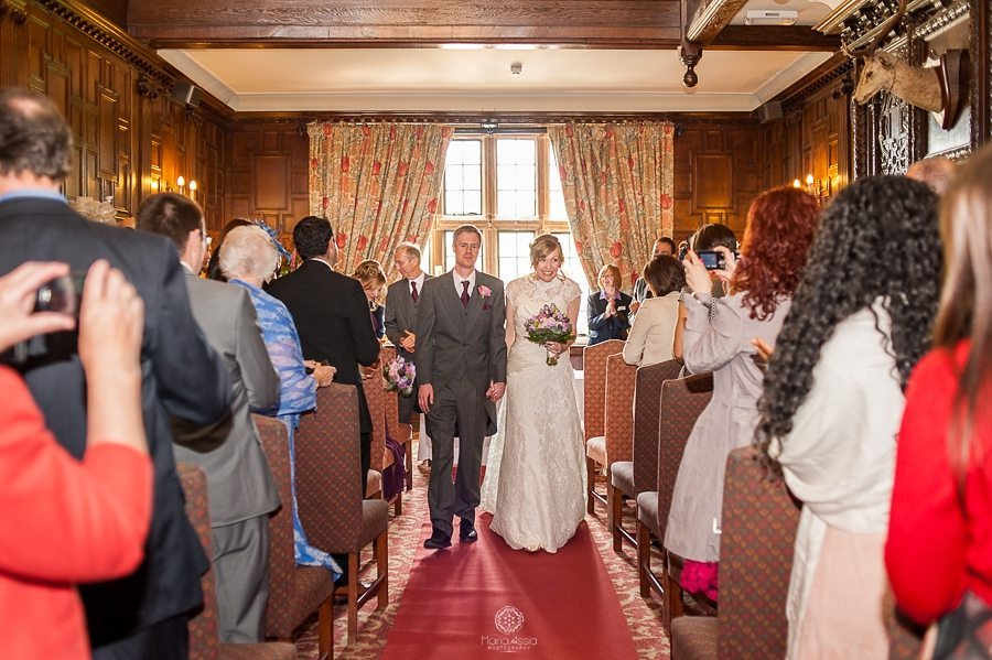 Bride and Groom walking down the aisle at their Billesley Manor Hotel Fuchsia Spring Wedding