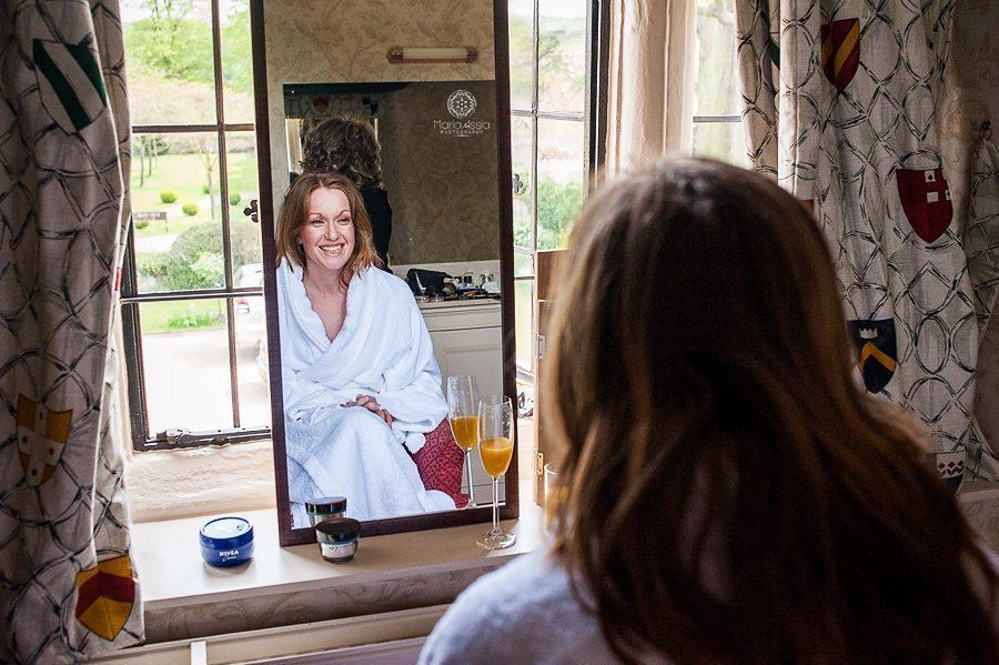 Bride getting ready for her Billesley Manor Hotel Fuchsia Spring Wedding