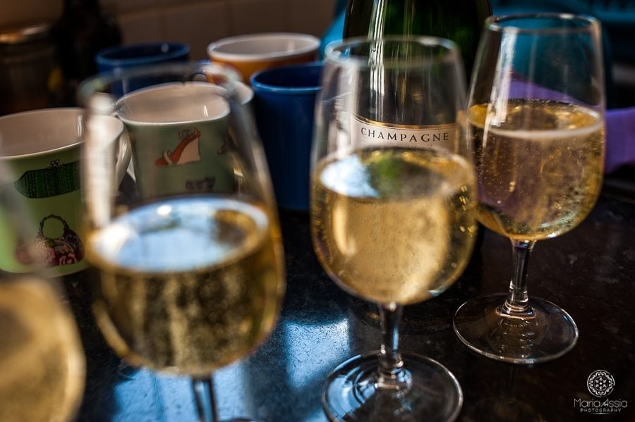 Champagne label seen through full champagne glasses at a vintage windsor wedding