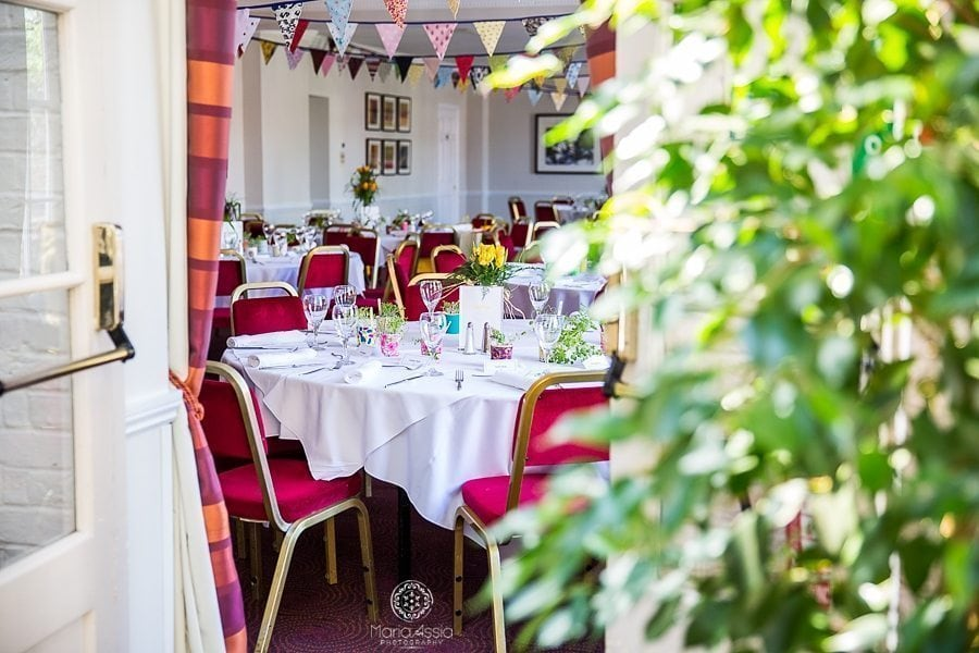 Colourful Vintage chic wedding themes bunting and wedding breakfast decor Horsley Towers