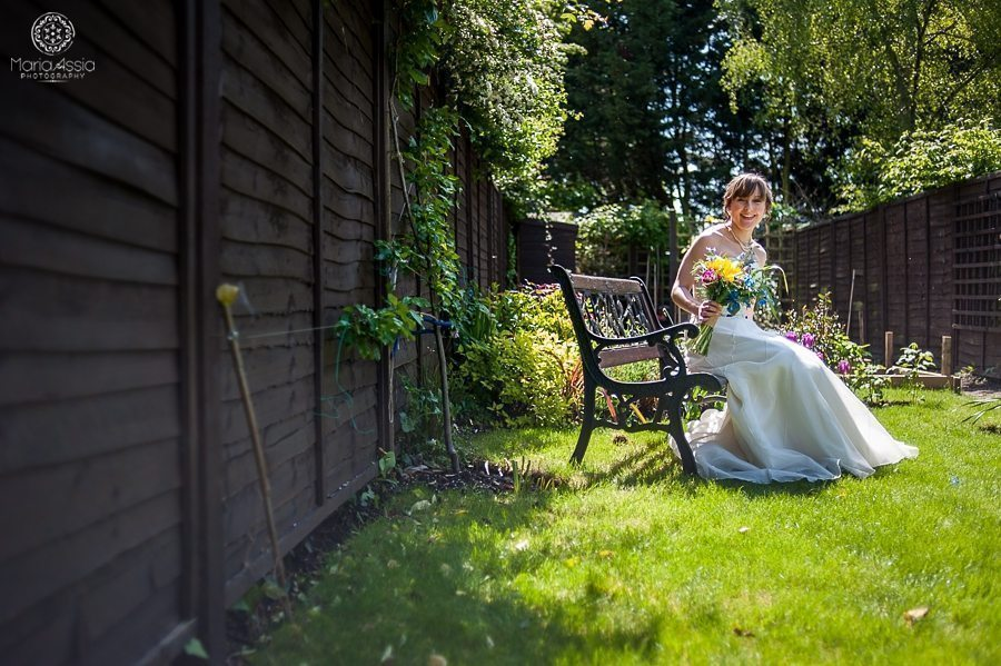 Bride sitting in her garden at her Vintage Windsor Wedding