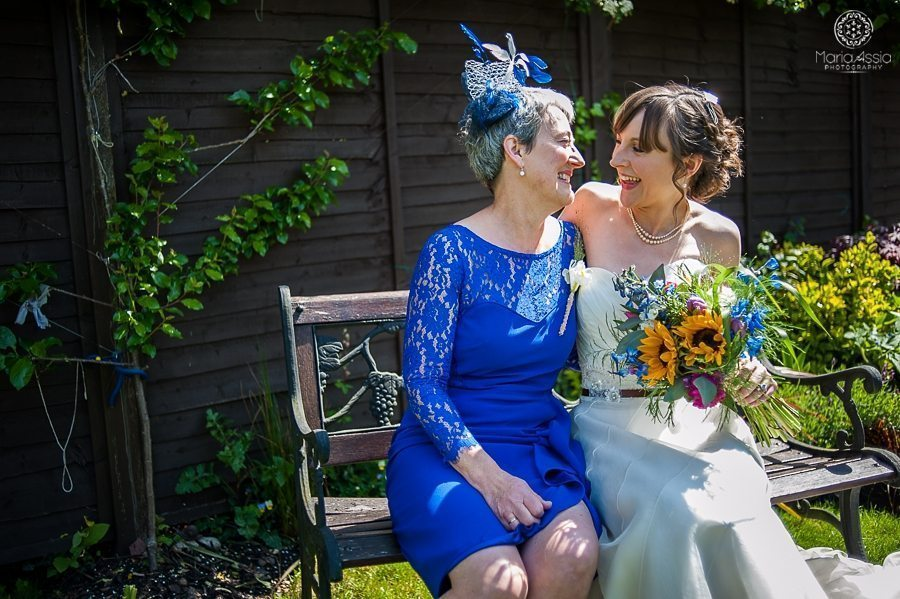 Bride and her mum hugging and laughing at each other