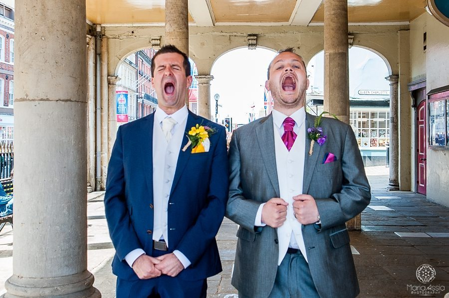 Groom and best man having fun at Sir Christopher Wren Hotel Vintage Windsor Wedding