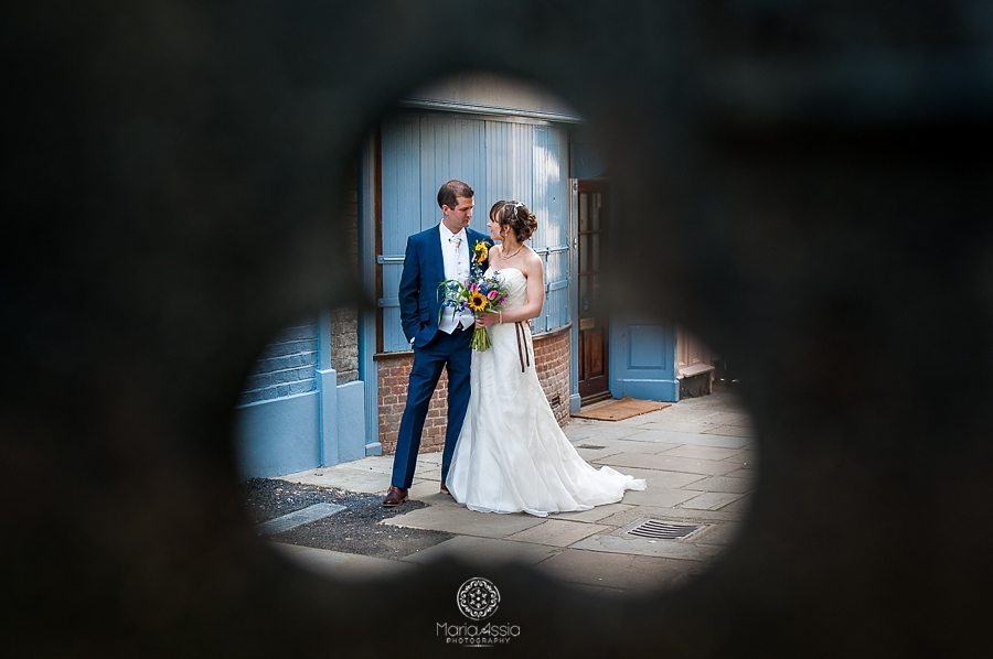 Bride and groom chatting in the alleys at their vintage windsor wedding