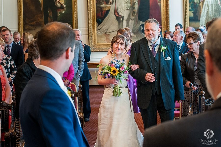 Bride walking down the aisle at Windsor Guildhall wedding