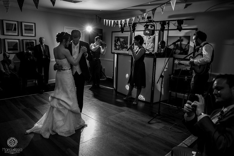 Black and white wedding first dance by alternative documentary wedding photographer Maria Assia Photography