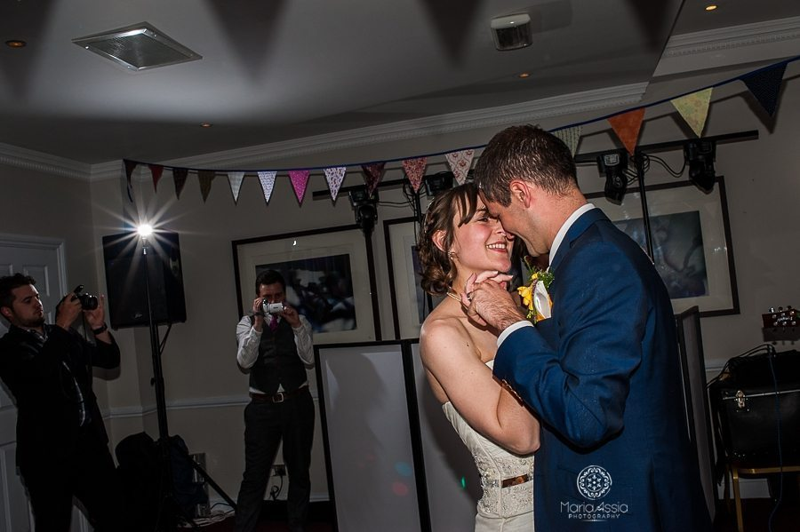 Bride and groom dancing their first dance at their Sir Christopher Wren Hotel Vintage Windsor Wedding