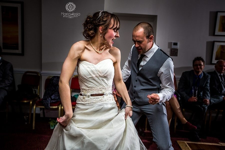 Rocking bride dancing with a wedding guest - Maria Assia Photography