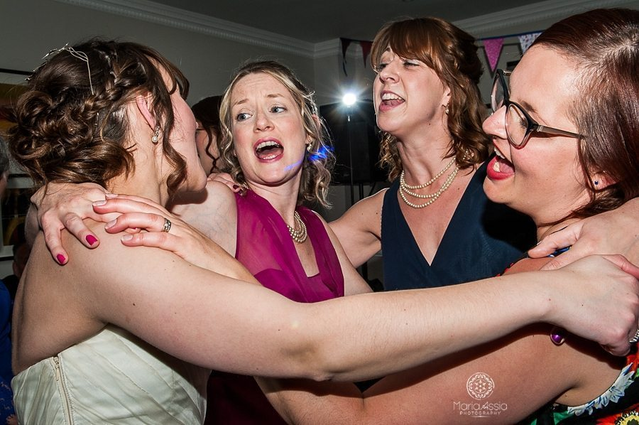 Bride singing with bridesmaids at her Sir Christopher Wren Hotel Vintage Windsor Wedding
