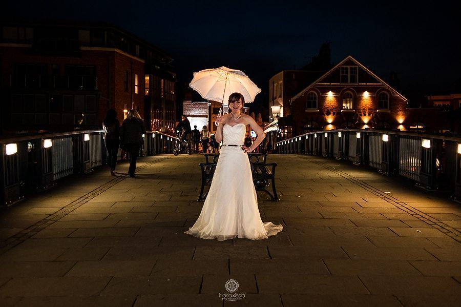 Nighttime bride portrait with her grandmother's umbrella Eton bridge, Windsor wedding photographer