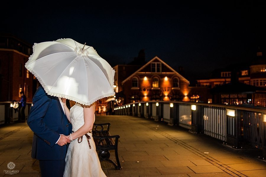 Bride and groom standing on Eton Bridge by Creative wedding photographer Maria Assia Photography