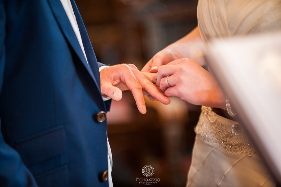 Bride and groom exchanging rings at their vintage windsor guildhall wedding