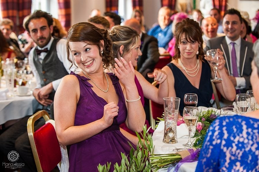 laughing wedding guest at the Sir Christopher Wren Hotel Vintage Windsor Wedding