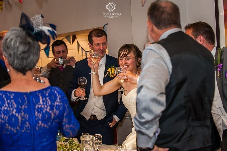 Bride and Groom toasting guests at the Sir Christopher Wren Hotel