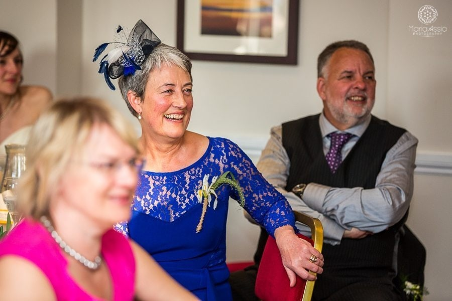 Bride's mother laughing at the speeches at a Vintage Windsor Wedding