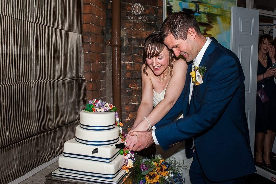 Bride and groom cutting their blue and white vintage wedding cake