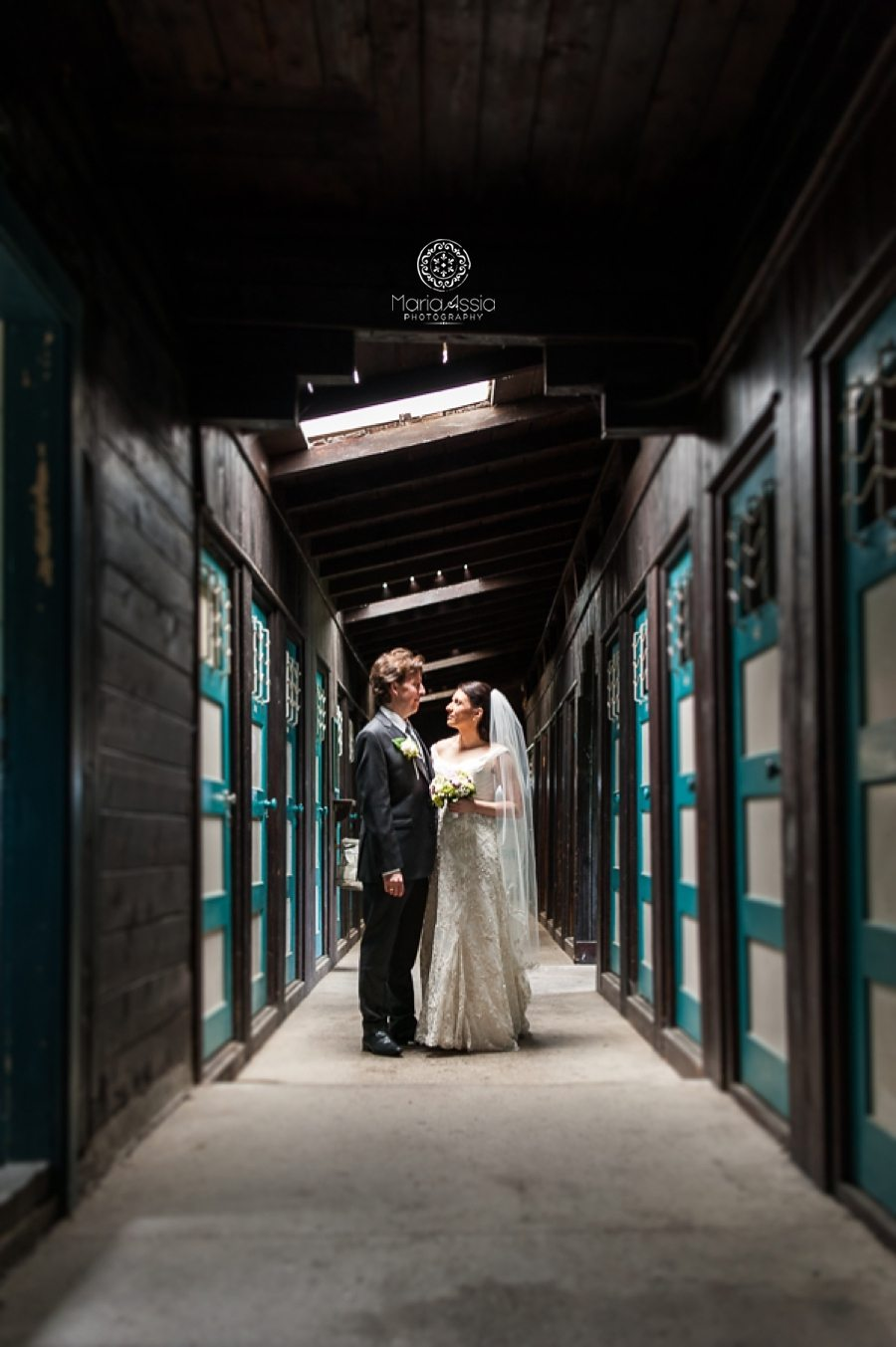 Austrian bride and groom standing in long black and white hallway