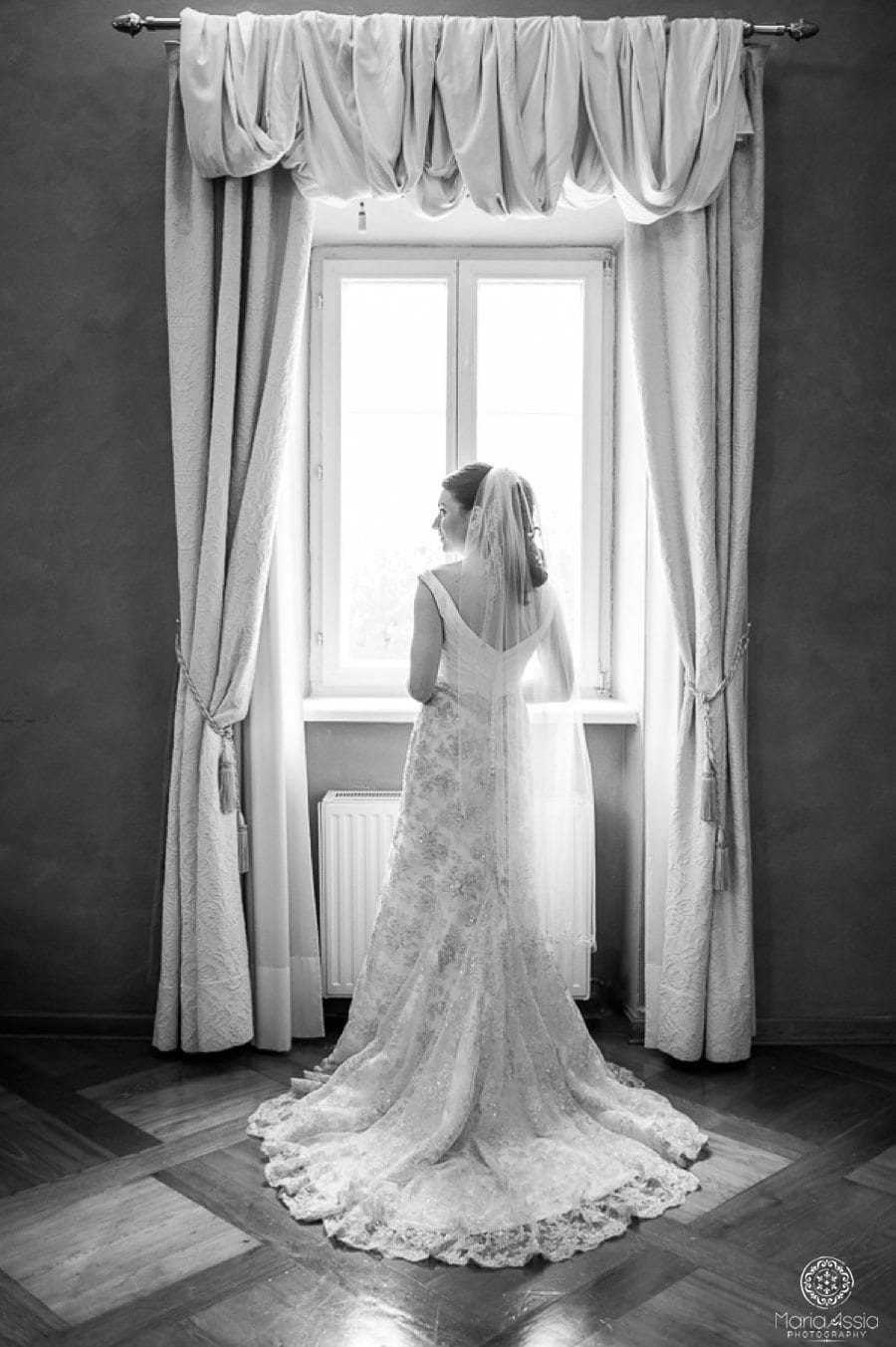 Austrian Bride standing in a window