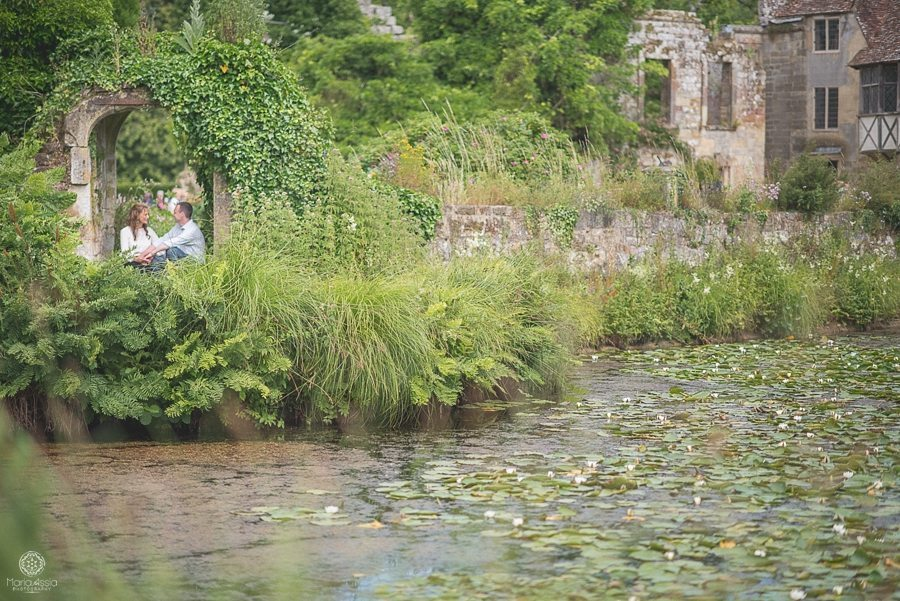 Couple sitting in ruined doorway at Scotney Castle