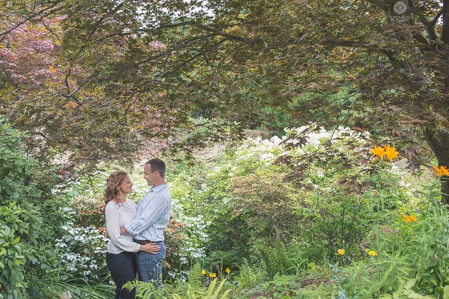 Couple standing in Scotney Castle quarry