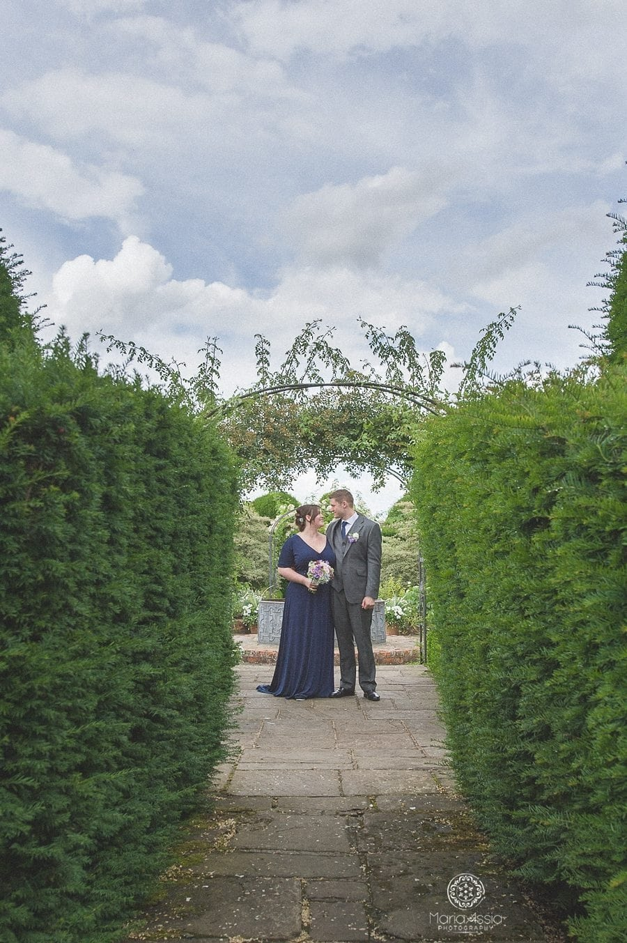 Bride and Groom at the topiary garden at Birtsmorton Court