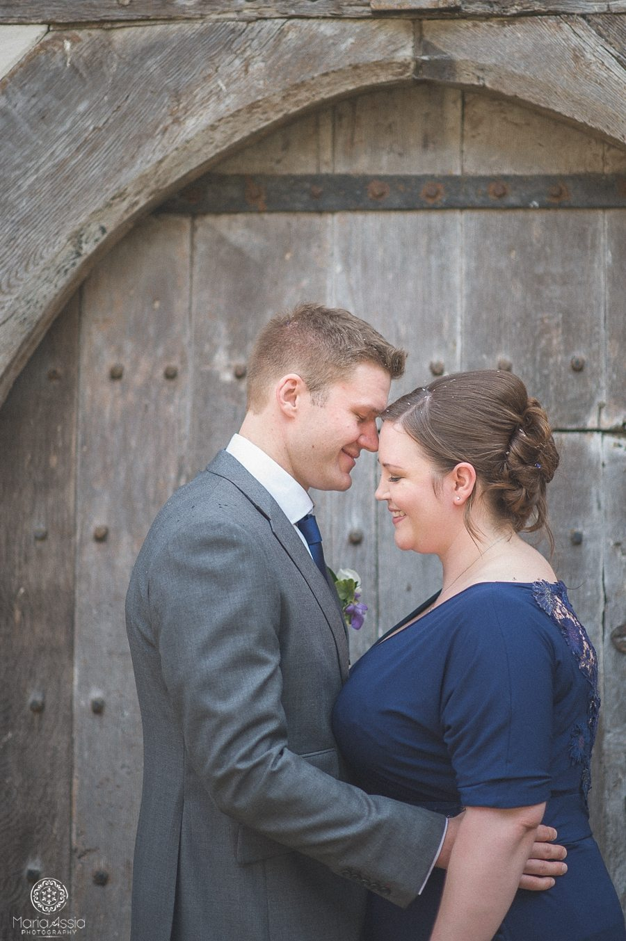 Wedding portrait of the bride and groom at their Birtsmorton Court navy blue wedding