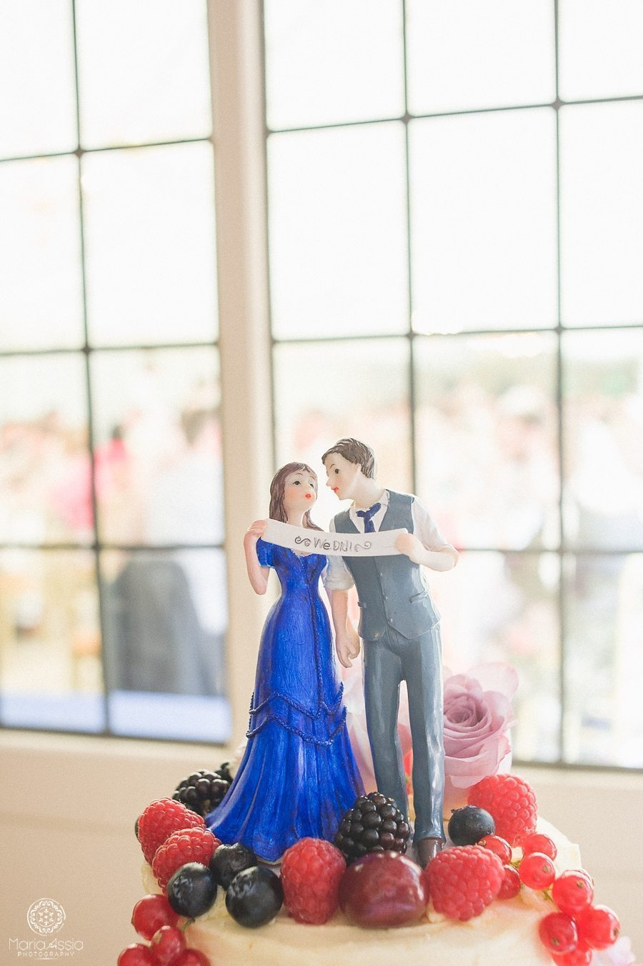 Cake topper at a Birtsmorton Court Navy Blue Wedding - Maria Assia Photography
