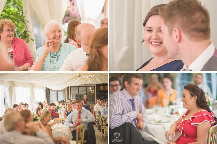Wedding guests laughing at speeches at Birtsmorton Court Navy Blue Wedding - Maria Assia Photography