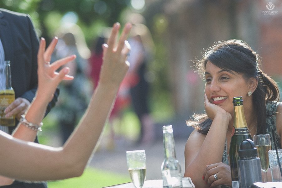 Chatting wedding guests at a Birtsmorton Court Navy Blue Wedding - Maria Assia Photography