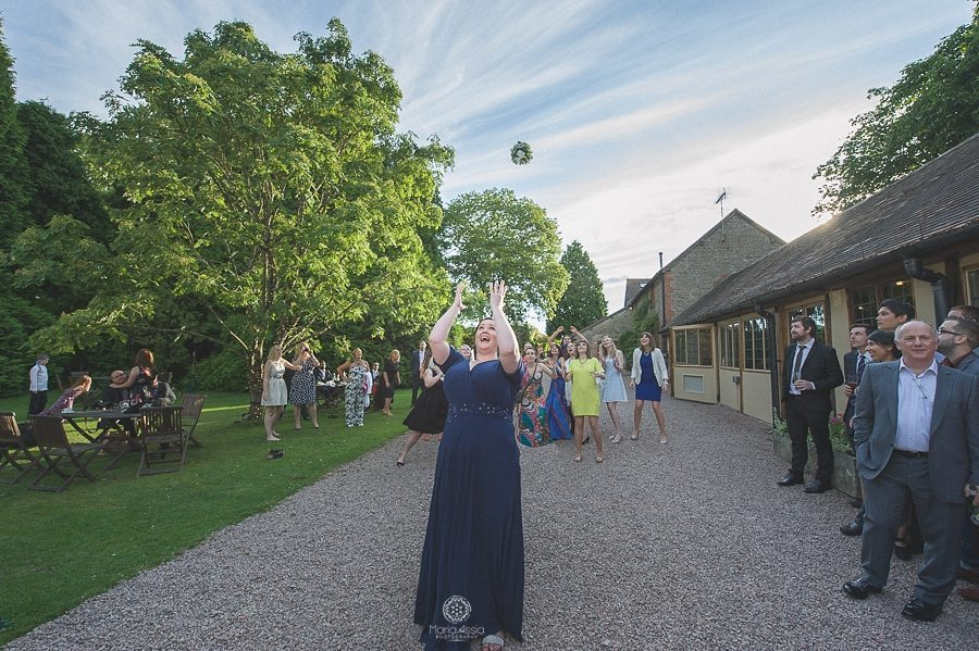 Bride throwing her bridal flowers at Birtsmorton Court wedding