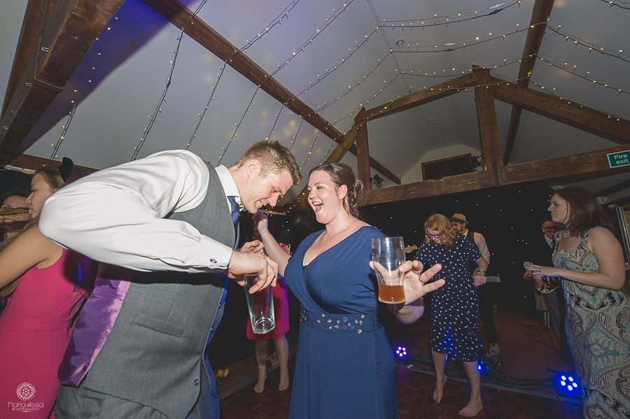 bride and groom dancing at their Birtsmorton Court Navy Blue Wedding - Maria Assia Photography