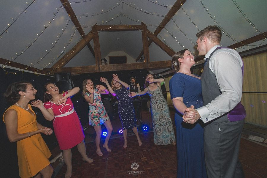 bride and groom dancing with their wedding guests at their Birtsmorton Court Navy Blue Wedding - Maria Assia Photography
