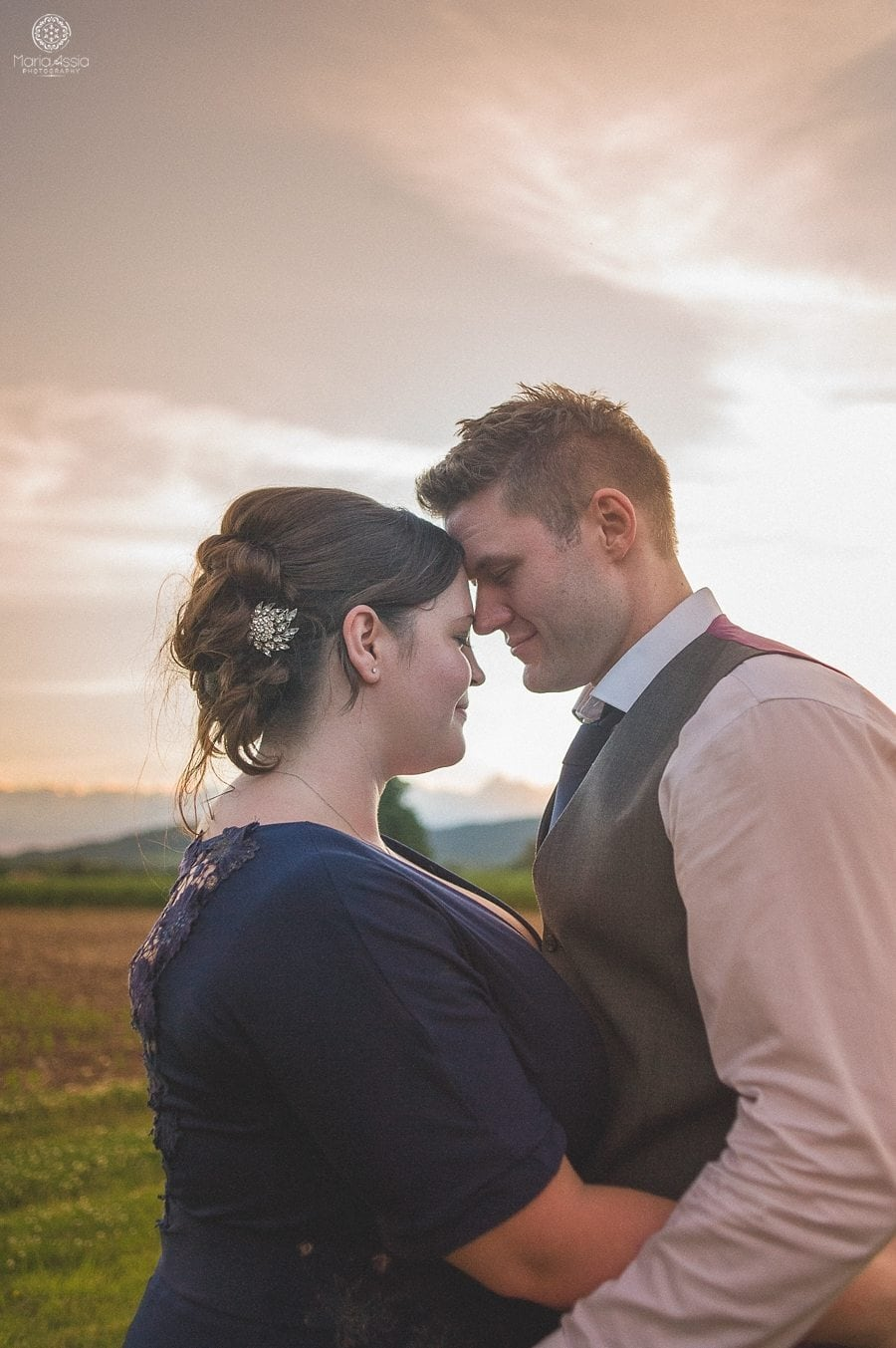 bride and groom at sunset at their Birtsmorton Court Navy Blue Wedding - Maria Assia Photography