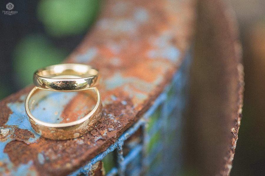 Wedding rings on a rustic box at a Birtsmorton Court Navy Blue Wedding - Maria Assia Photography