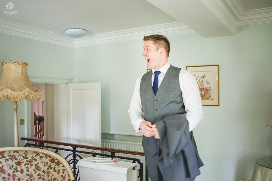 Groom's reaction to the bride at their Birtsmorton Court Navy Blue Wedding - Maria Assia Photography