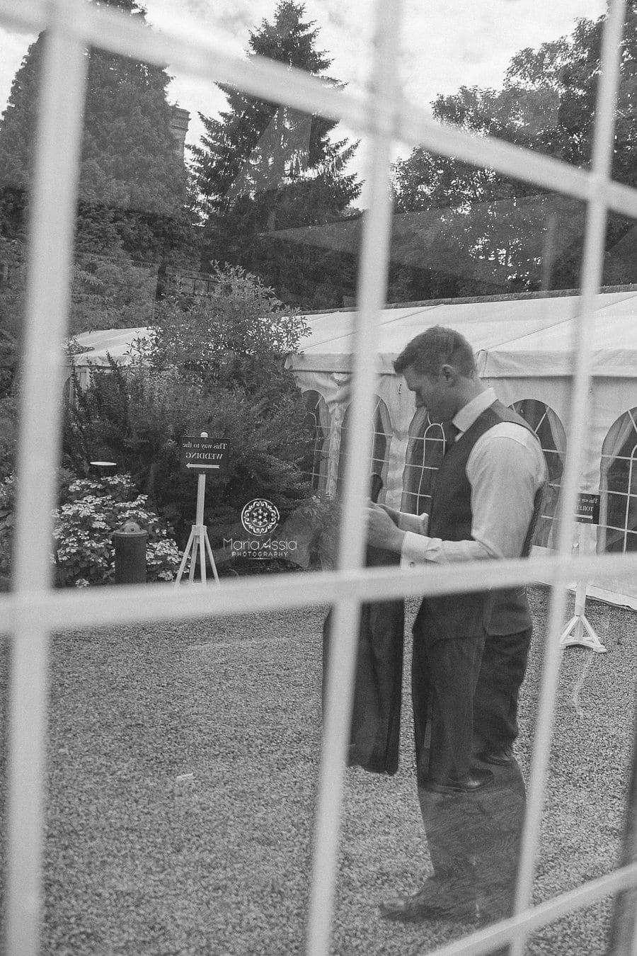 Groom reflecting in the mirror at Birtsmorton Court Navy Blue Wedding