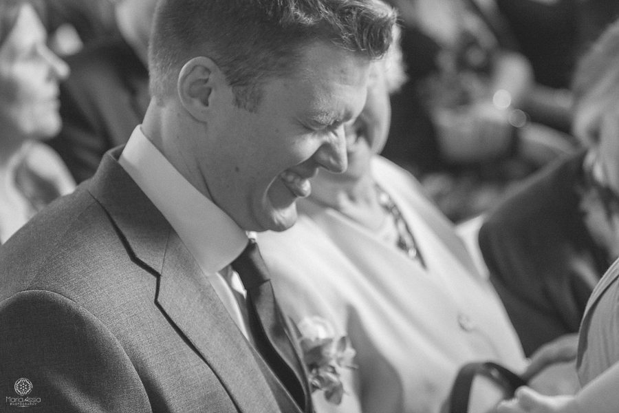 laughing groom at Birtsmorton Court Navy Blue Wedding - Maria Assia Photography