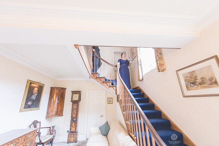Bride walking down the stairs - Birtsmorton Court Navy Blue Wedding - Maria Assia Photography