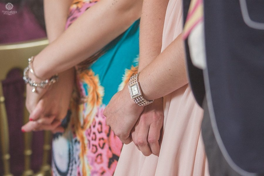 Wedding guests holding hands at a Birtsmorton Court Navy Blue Wedding - Maria Assia Photography