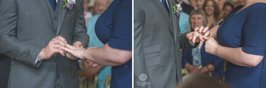 Bride and groom exchanging rings at their Birtsmorton Court Navy Blue Wedding - Maria Assia Photography