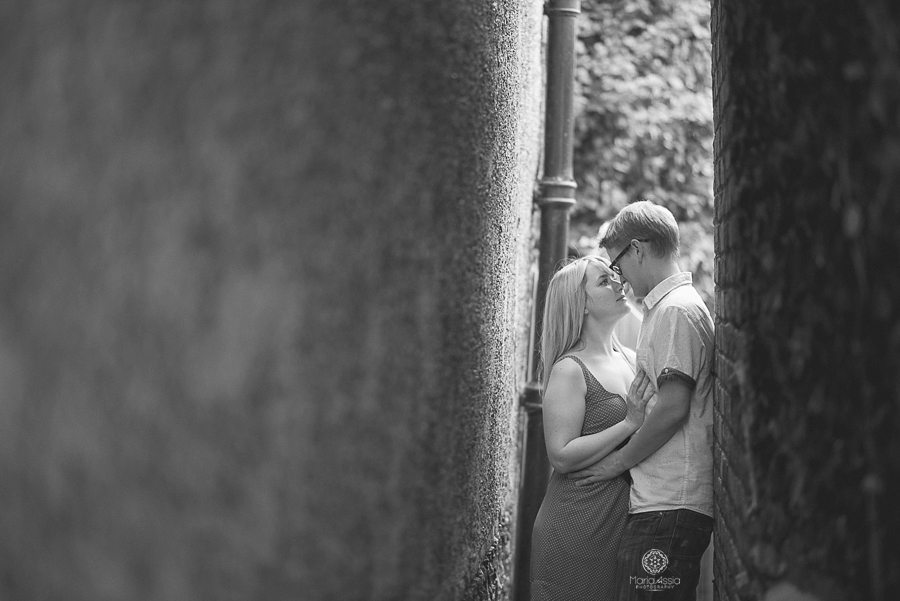 a Couple standing in a narrow walkway in Kent