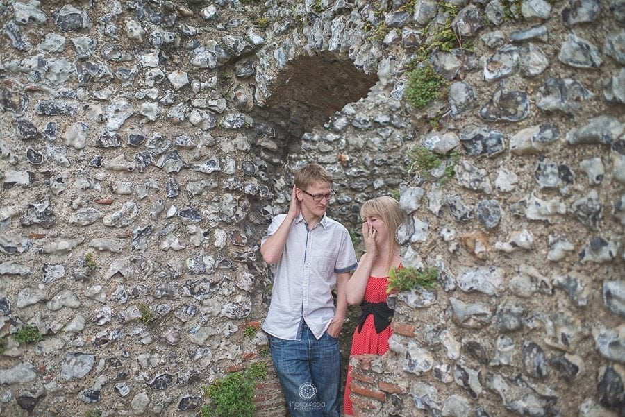 Engaged Couple laughing in the ruins at Eynsford Castle