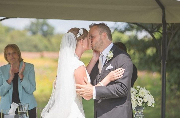 Bride and groom kissing at their wedding ceremony