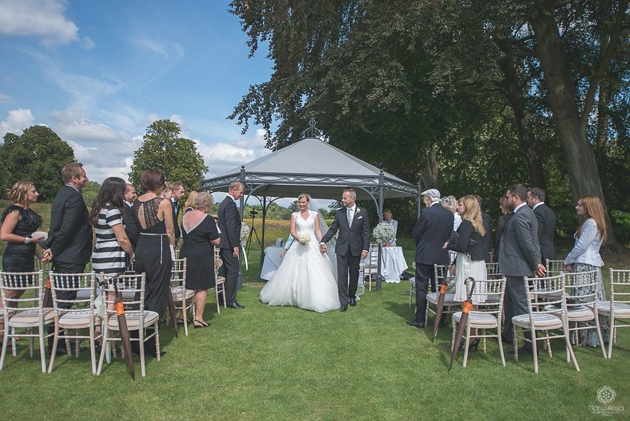 Coworth Park Wedding Photography of a couple walking down the aisle