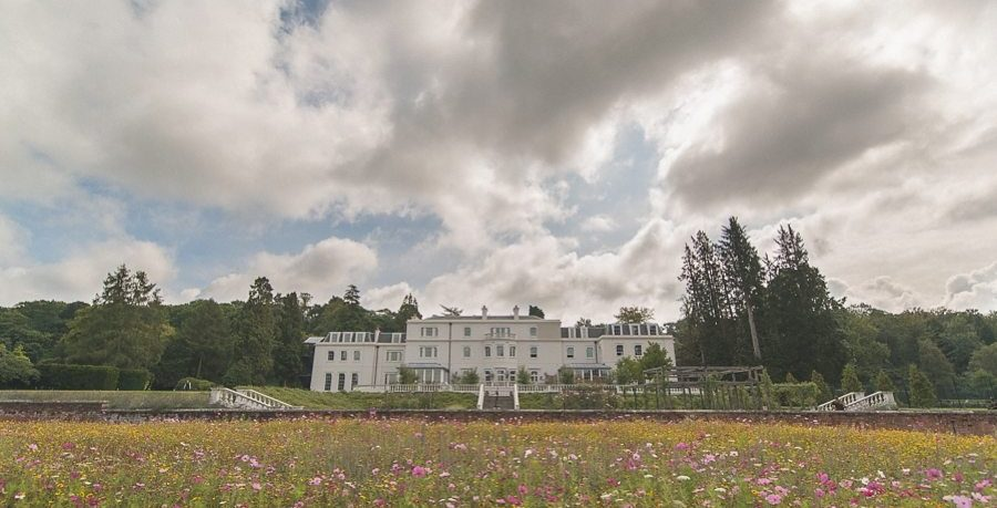 Coworth Park Mansion and wildflower meadow