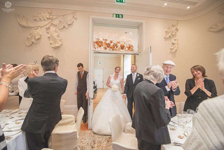 Bride and groom entering the reception room