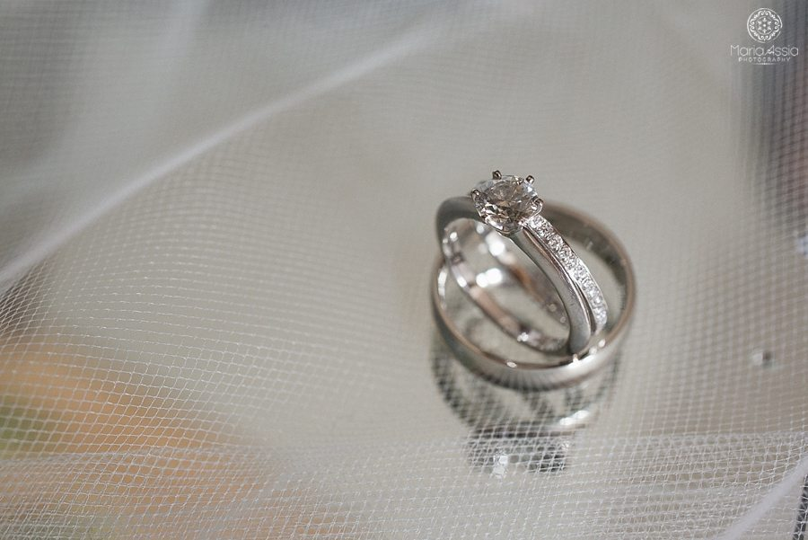 Macro Photo of wedding rings through a veil at Coworth Park Wildflower Meadow Wedding