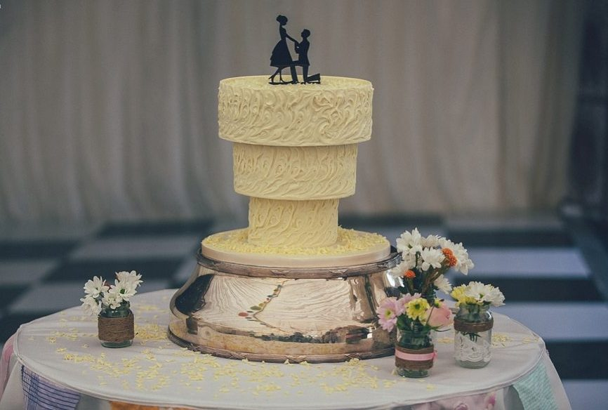 Alice in Wonderland wedding theme Upside Down wedding cake