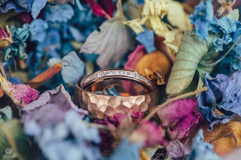 Alice in Wonderland wedding theme Wedding rings surrounded by confetti