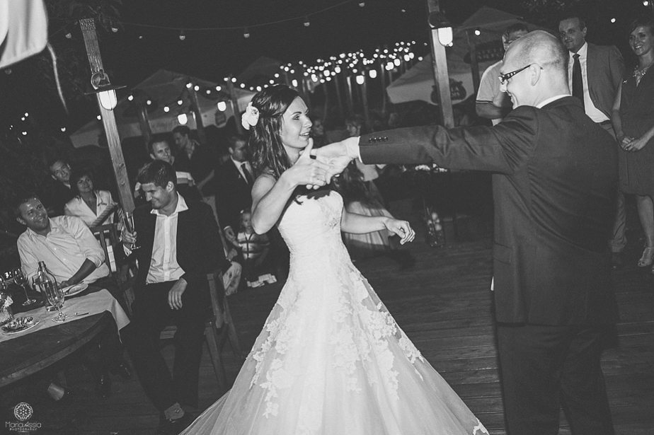 Bride and groom dancing together and twirling.jpg